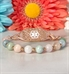 Rose gold and pastel beaded medical ID bracelet on marble