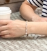 Woman wearing Krista Stretch Bracelet with rose gold beads and crystals