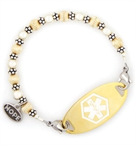14 carat gold-filled and sterling silver beads interchangeable bracelet with stainless steel lobster clasps at each end attached to gold ID tag