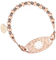 Rose gold bracelet with detailed and smooth beads and silver accents between them, shown with med alert tag