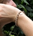 Interchangeable bracelet: Sterling silver and rose gold filled beads shown on wrist