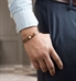 Man wearing the Maverick Medical ID Bracelet, a stainless medical alert band with copper brown finish and white caduceus