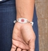 stainless steel white silhouette medical ID tag shown on wrist