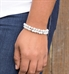 Double strands of Moonstone and white jade beads with sterling silver and crystal beads shown on wrist