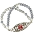 Girl wearing interchangelable bracelet made of Cubic zirconia dangle charm in sterling silver bezel Silver, Silver-fill, and crystal beads attached to filigree medical ID tag