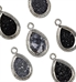 Close up view of black oval shaped druzy stones set in silver