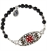 Interchangeable black beaded bracelet with silver accents attached to floral medical ID tag