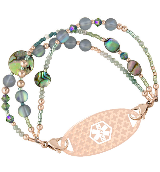 Three strands of abalone, quartz and crystal beads attaches to an engravable medical ID tag
