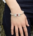 mon petite tag attached to mara stretch bracelet shown on wrist