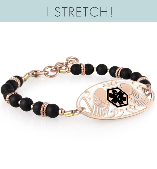 Black beaded bracelet with rose gold accents and affixed med alert tag with black symbol and angel wing detail