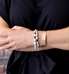 Woman wearing beaded medical ID bracelet with rose gold med ID cuff