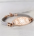Rose gold and silver adjustable medical ID bracelet on marble
