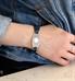 Woman wearing rose gold and blue adjustable medical ID bracelet