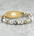 C485 - Hailey Bracelet multi colored beads and crystals with gold medical ID tag with a white medical ID symbol on marble