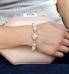 Woman wearing jade and rose gold beaded medical alert bracelet