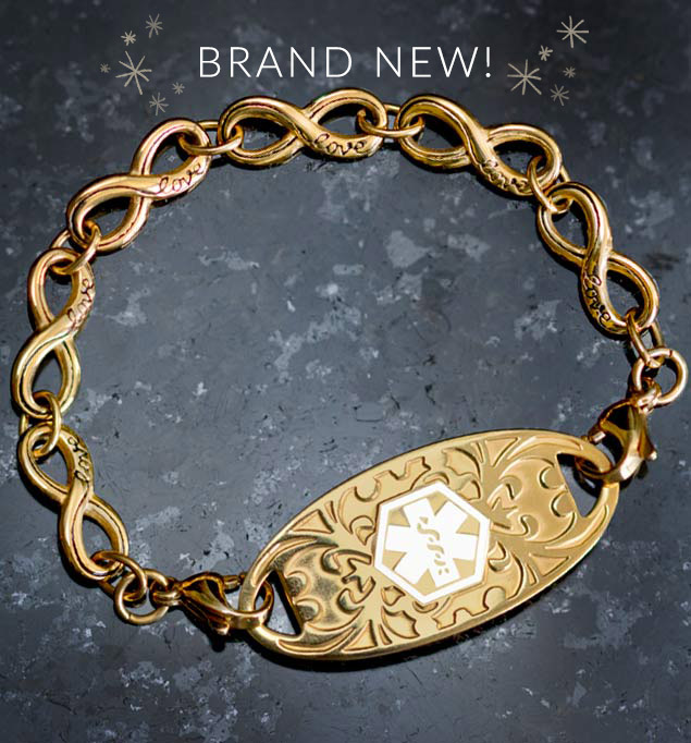 Gold tone stainless steel medical alert bracelet with infinity links on slate background
