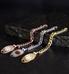 Rose gold, silver, and gold faceted curb chain medical alert bracelets on black slate background
