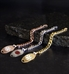 Rose gold, silver, and gold faceted curb chain medical alert bracelets on black slate background