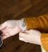 Woman showing custom laser engraved medical ID tag on multi-strand beaded medical alert bracelet