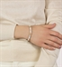 Woman wearing gold and howlite beaded stretch medical alert bracelet
