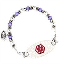 Tanzanite Swarovski crystals, sterling silver, and Bali beads interchangeable bracelet attached to white silhouette ID tag shown on white background
