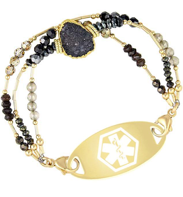 Gold and black women's crystal bracelet with black druzy centerpiece and gold med ID tag with white symbol
