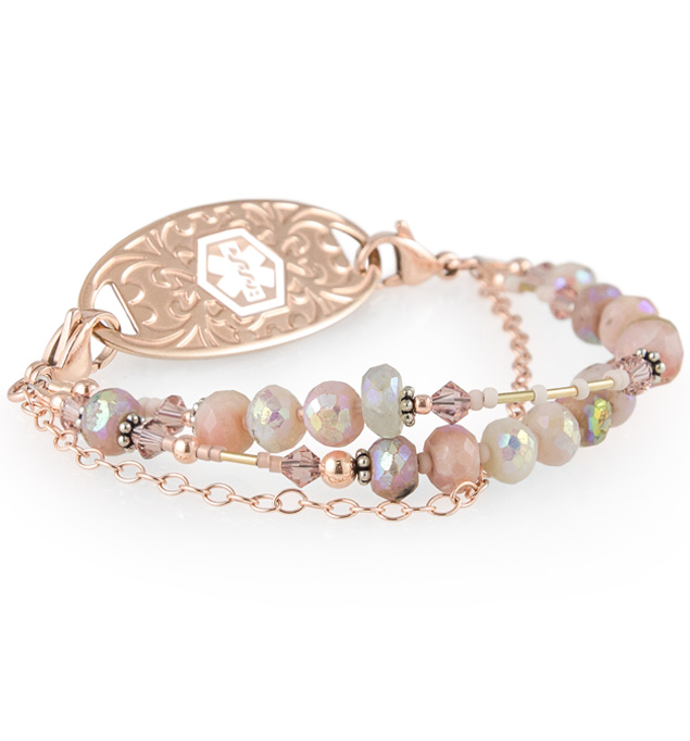Pink, peach, and cream crystal bracelet with two beaded strands and one rose gold chain and matching ID tag