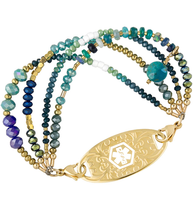 Green opals, blue jade, and gold nugget beads with varying blue and green accent crystals interchangeable ID bracelet attached to gold gardenia ID tag