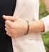 Woman wearing Gunmetal t-link medical ID bracelet