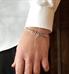 Man wearing silver tone t-link medical ID bracelet