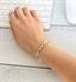 Woman wearing silver tone t-link medical ID bracelet