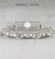 Sterling silver bridle chain medical alert bracelet with decorative alert tag on marble background