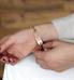Woman showing custom laser engraved medical alert tag