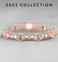 Rose gold bridle chain medical alert bracelet with decorative alert tag on marble background