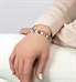 Woman wearing stretch medical alert bracelet with beaded accents in pink and silver