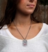 Woman wearing Filigree Medical Alert Dog Tag Necklace. Stainless dog tag, antique finish, Celtic pattern, red caduceus, chain