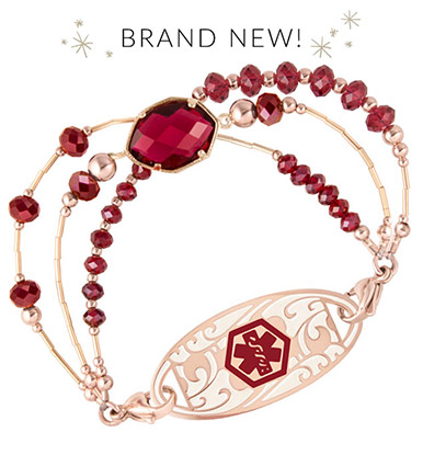 Multi-faceted, gold bezel-set ruby red center stone accented with Gold and Rose gold elements interchangeable bracelet attached to rose filigree ID tag