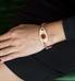 rose gold filigree ID tag shown on wrist