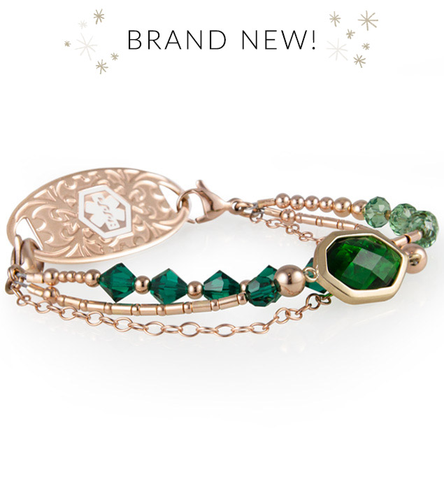 Rose gold and emerald green medical ID bracelet with large green center stone