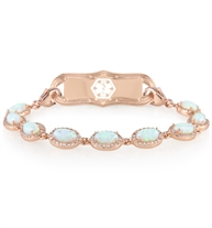 Simulated opal and CZ rose gold bracelet with lobster clasps at each end. Shown with a matching rose tone tag.