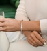 Woman wearing rose gold and crystal Audrey Medical ID Tennis Bracelet