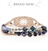 Rose gold beaded medical ID bracelet with navy blue crystals and rose gold accents