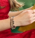Woman wearing rose gold beaded medical ID bracelet with navy blue crystals and rose gold accents