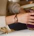 Woman wearing rose gold beaded Valentina Medical ID Bracelet