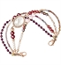 Rose gold beaded medical ID bracelet with red, maroon, pink and purple crystals and clear center stone no tag