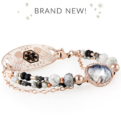 Rose gold beaded medical ID bracelet with dendritic opal centerpiece stone and rose gold medical ID tag with angel wings and black medical symbol
