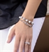 Woman wearing the Wow Factor Stretch Med ID Bundle, 2 silver-tone 1-strand beaded stretch bracelets the Carrie and the Londyn