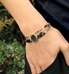 Woman wearing Cher Medical ID Bracelet includes black and gray crystals with yellow gold accents