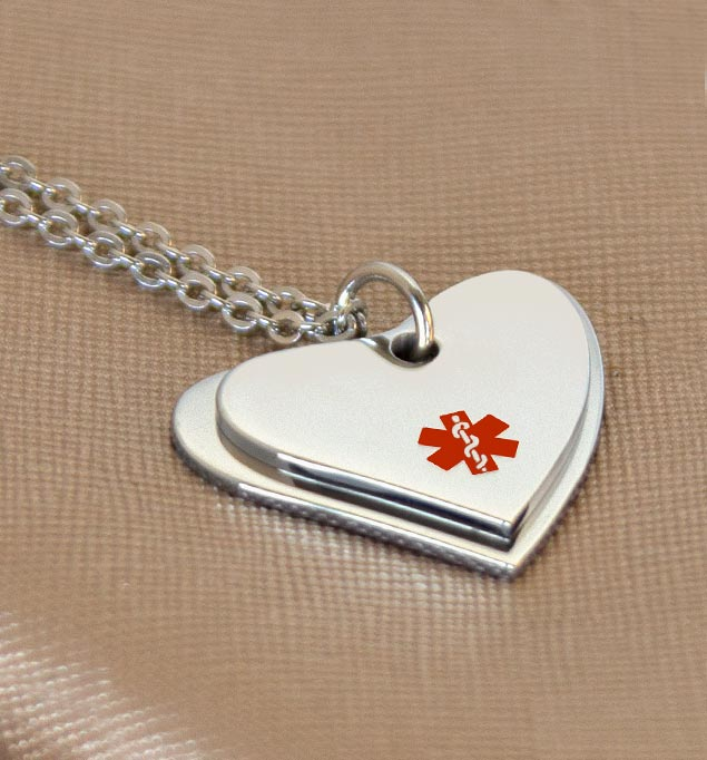 Stainless steel dual heart medical ID necklace on stainless steel ball chain.