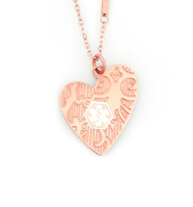 Rose Gold Close To My Heart Medical ID Necklace. Plated stainless asymmetrical heart pendant, textural detail, white caduceus
